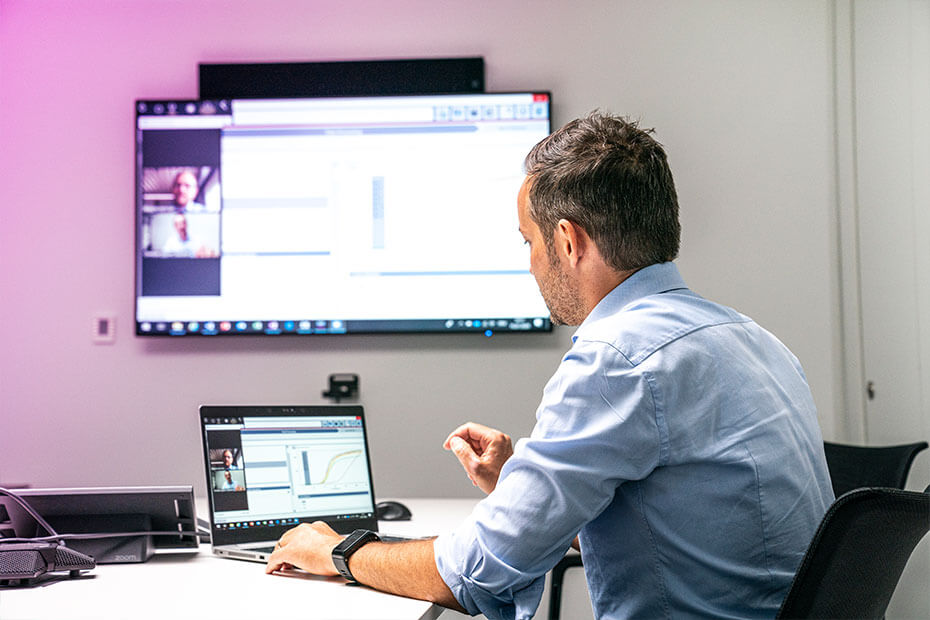 Sales employees holding a virtual meeting